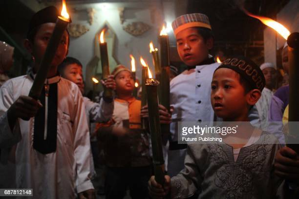 Muslim kids youth and parents participated in a torch parade around the village to celebrate the holy month of Ramadan on May 24 2017 in Surabaya...