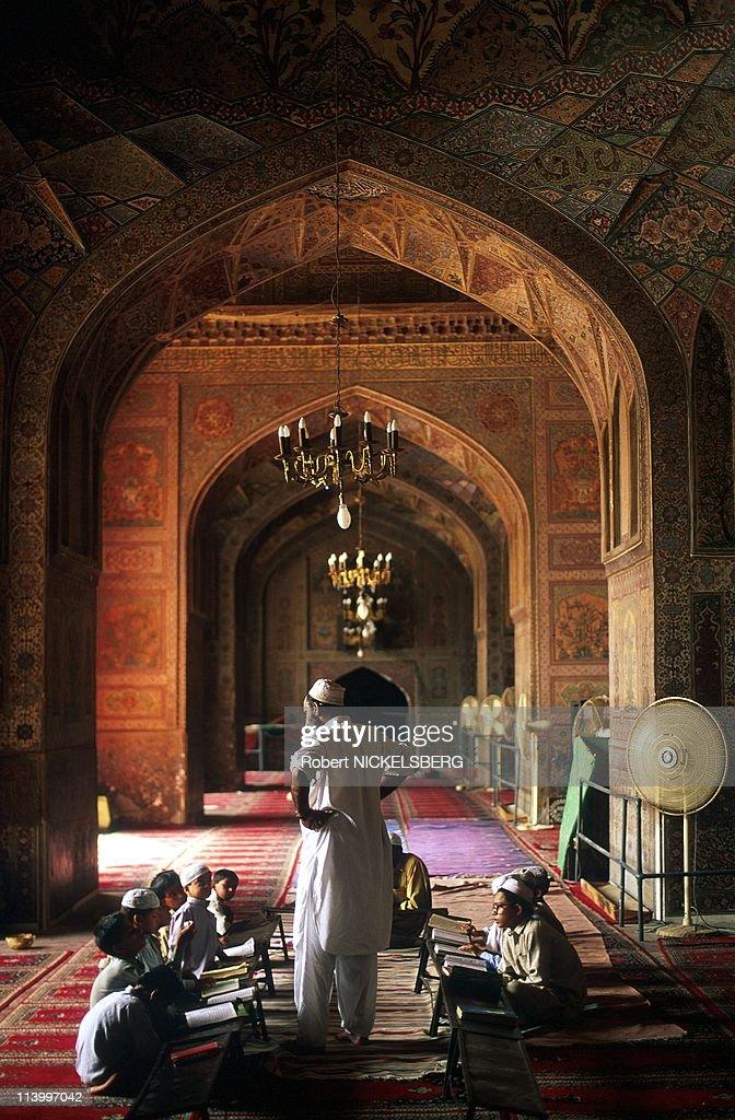 Muslim Koranic School in Masjid Wazir Khan (17th cent- Mosque) In Lahore, Pakistan In July, 1997- : News Photo