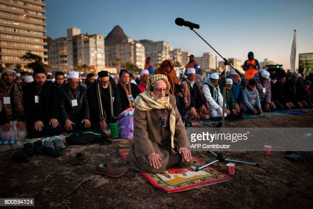 A Muslim leader leads the evening prayer at Three Anchor Bay in Cape Town on June 24 as Islamic leaders attempt to sight the new moon which would...