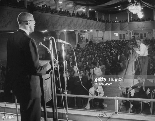 Muslim leader Malcolm X speaking to unidentified African American group