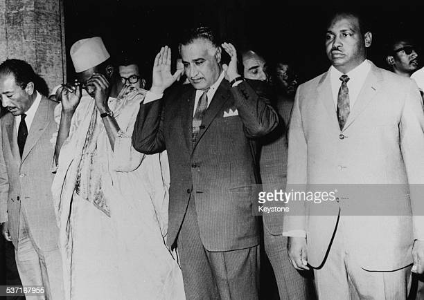 Muslim leaders at prayer Anwar Sadat Moussa Traore President Gamal Abdel Nasser and a member of the Mali delegation at Al Azhar Mosque Cairo Egypt...
