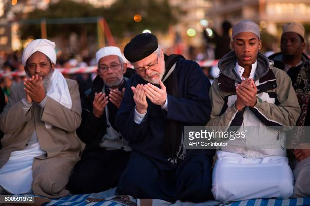 Muslim leaders pray as they attend the evening prayer at Three Anchor Bay in Cape Town on June 24 as Islamic leaders attempt to sight the new moon...