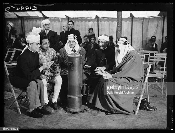 Muslim leaders warming themselves at a heater Woking 6 January 1935 A photograph of a group of Muslim leaders warming themselves around a heater at...