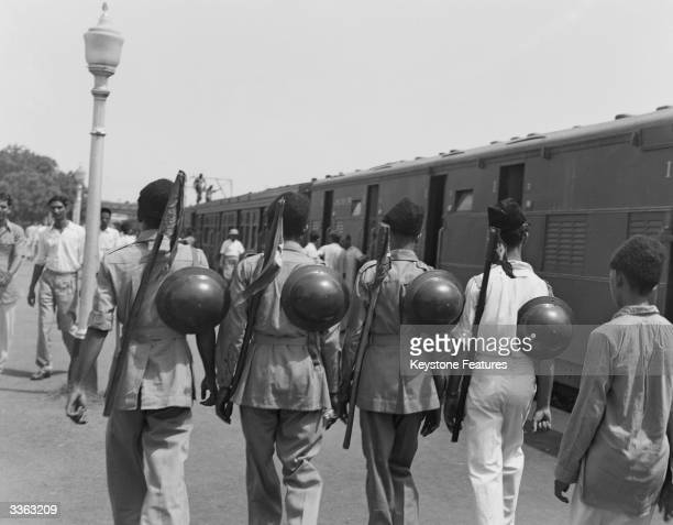 Muslim League National Guards on a platform at a railway station in New Delhi India August 1947 They are helping with the departure of six hundred...