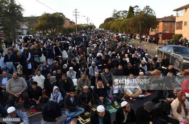 Muslim listen a sermon outside the Lakemba mosque prior to Eid alAdha prayer in Sydney on September 1 2017 Muslims living in Australia celebrate Eid...