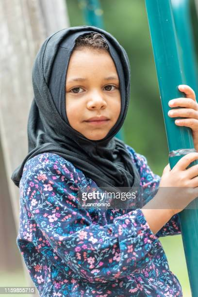muslim little girl at her first day of school - native african girls stock pictures, royalty-free photos & images