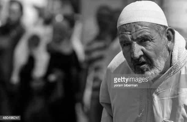 Muslim man, at Jerusalem, Israel, staring at the camera with a suspicious facial expression