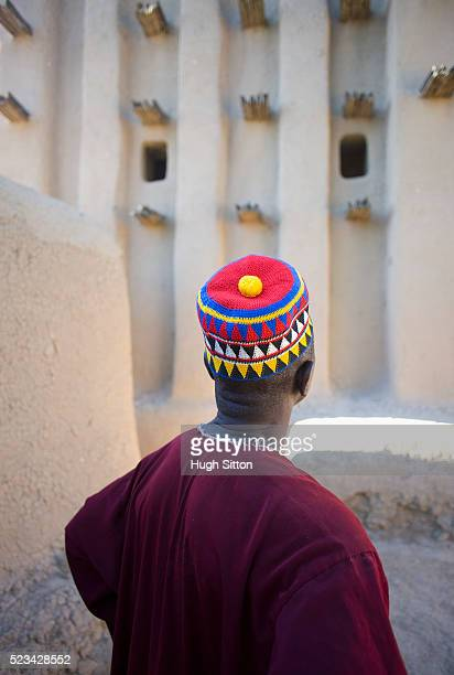 muslim man at sirimou mosque - hugh sitton stock pictures, royalty-free photos & images