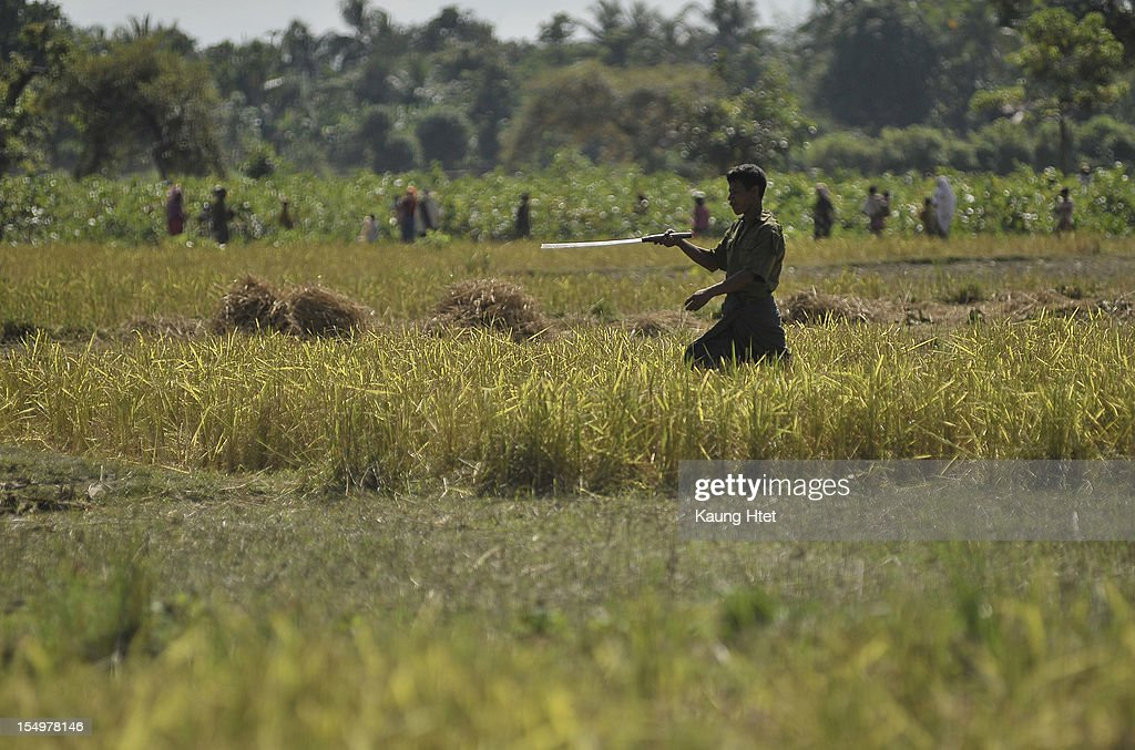 A Muslim man carries a sword after hearing the rumour of Rakhines coming to their Muslim quarter in Pa Rein village, Myauk Oo township on October 29, 2012 in Rakhine state, Myanmar. Over twenty thousand people have been left displaced following violent clashes which has so far claimed a reported 80 lives. Clashes between Rakhine people, who make up the majority of the state's population, and Muslims from the state of Rohingya began in June.