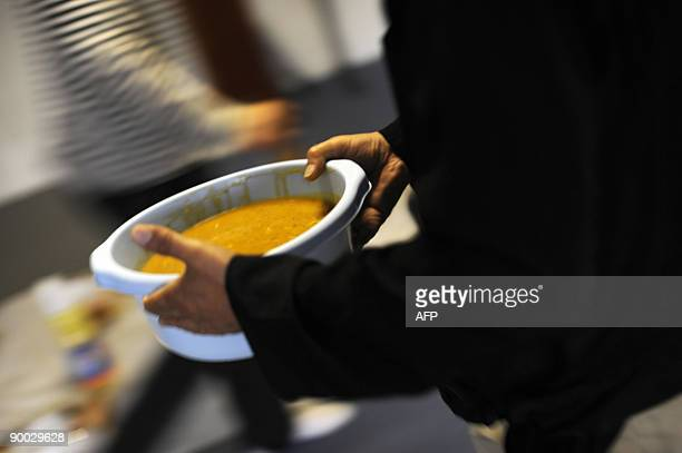 A Muslim man carries Morrocan harira soup for the breaking of the fast in AnNour mosque on the second day of the holy fasting month of Ramadan or...