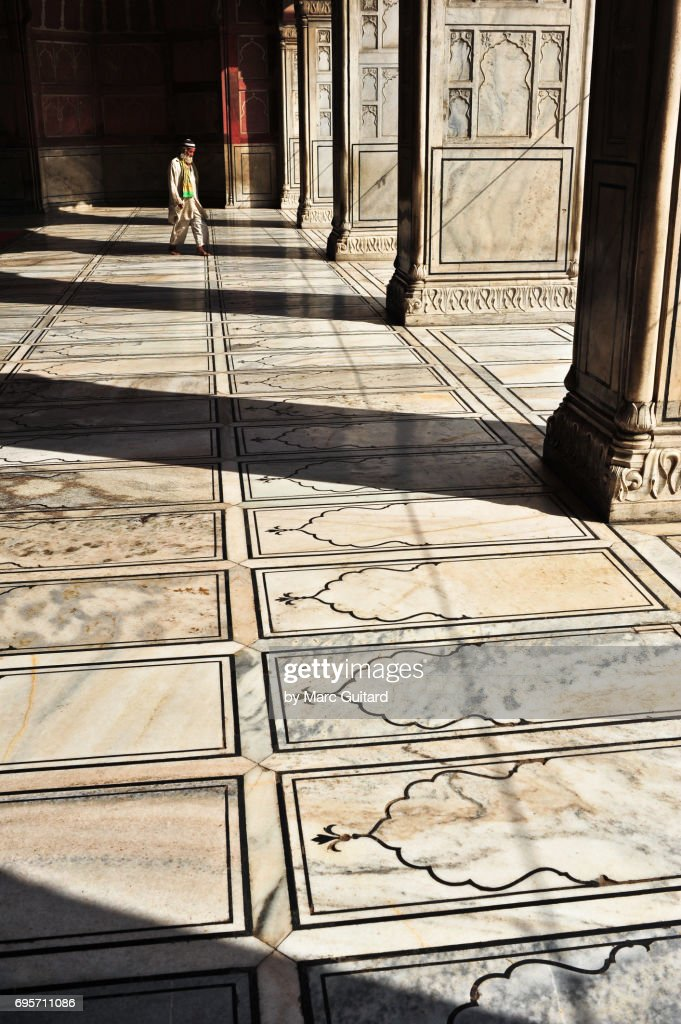 A Muslim man exiting the Jama Masjid Mosque in Old Delhi, India : Stock Photo