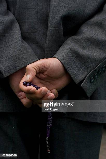 muslim man holding misbaha - faith rogers stock pictures, royalty-free photos & images