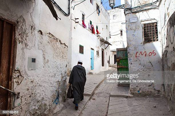 muslim man in white medina - tetouan stock photos and pictures