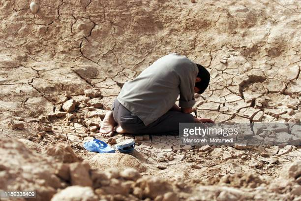 muslim man is crying - syria stock pictures, royalty-free photos & images