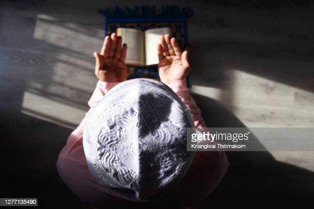 a muslim man is doing salah at home. - religion stock pictures, royalty-free photos & images