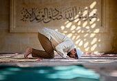 Muslim man is praying in mosque