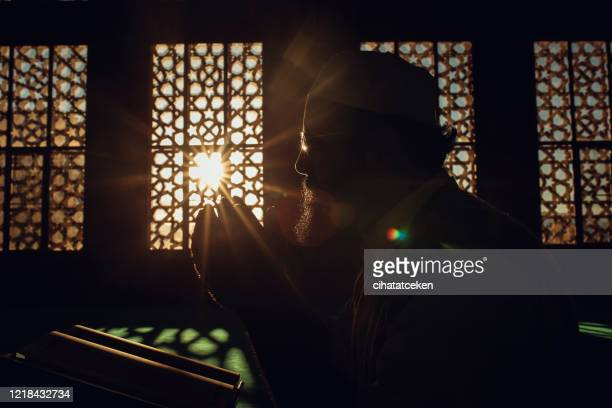 muslim man is praying in mosque - fasting activity stock pictures, royalty-free photos & images
