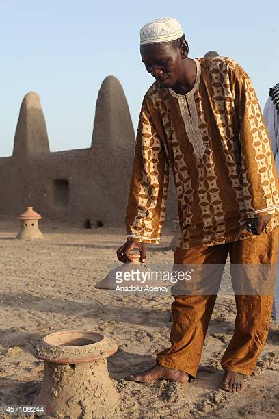 A muslim man is seen inside of the mud mosque in Djenne Mali on October 6 2014 The Great Mosque of Djenne is the largest mud brick building in the...