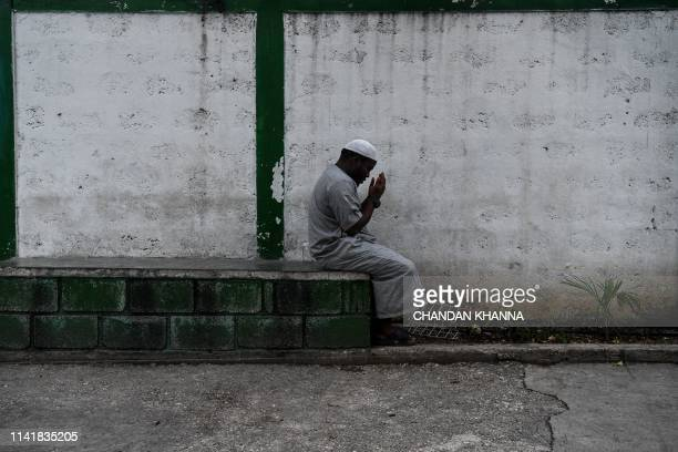 Muslim man offer prayers prior iftar the meal after sunset at the Masjid AtTawheed mosque on the first day of the Muslim holy month of Ramadan in...