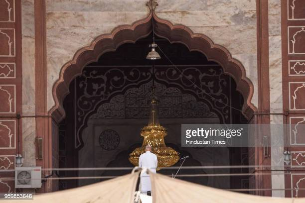 Muslim man offers prayers on the first Friday of the holy month of Ramadan at the Jama Masjid on May 18 2018 in New Delhi India Muslims all over the...
