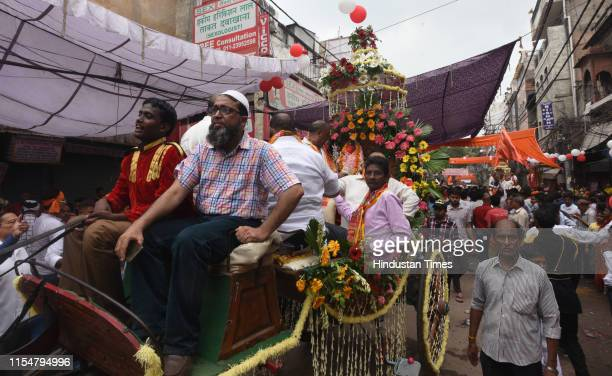 Muslim man participates in the 'Shobha Yatra' procession at Hauz Qazi Lal Kuan Chandni Chowk area on July 9 2019 in New Delhi India The temple which...