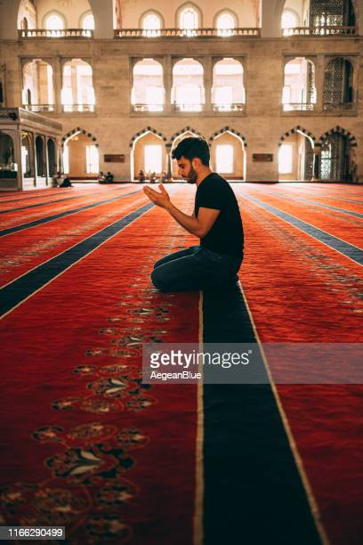muslim man praying in mosque - islam stock pictures, royalty-free photos & images