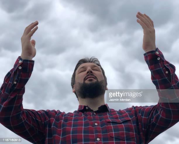 muslim man praying outdoors - allah stock-fotos und bilder