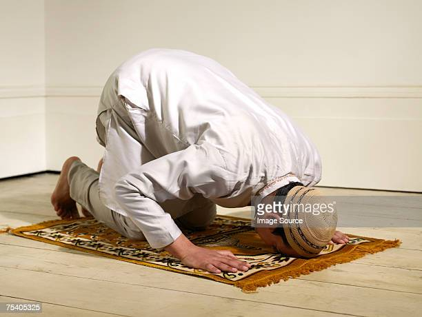 muslim man praying - praying stock pictures, royalty-free photos & images