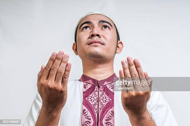 Muslim man praying to god and looking up