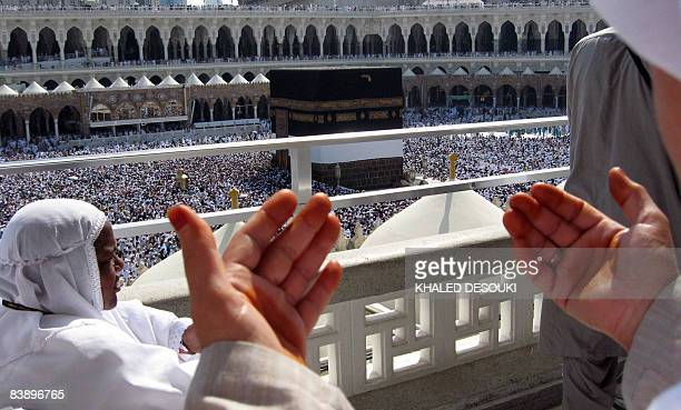 A Muslim man prays at the Grand Mosque as thousands of pilgrims circle around the Kaaba to perform Tawaf as part of the Hajj in the Saudi holy city...