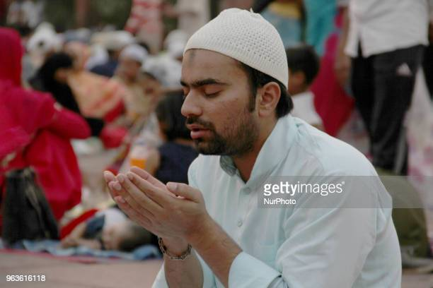 A muslim man prays before breaking his fast at Jama Masjid in the old quarters of Delhi India on 29 May 2018