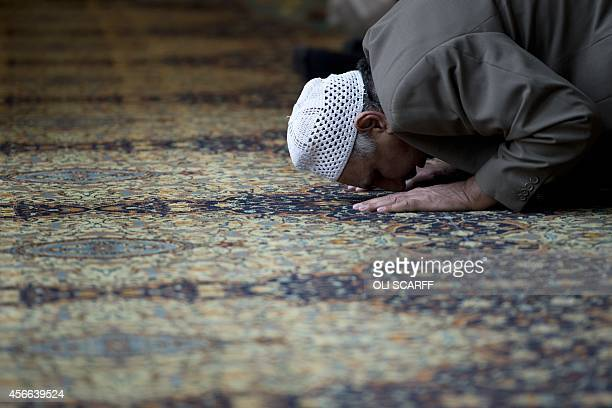 A muslim man prays during a prayer session for murdered aid worker Alan Henning in Manchester Central Mosque in Manchester north west England on...