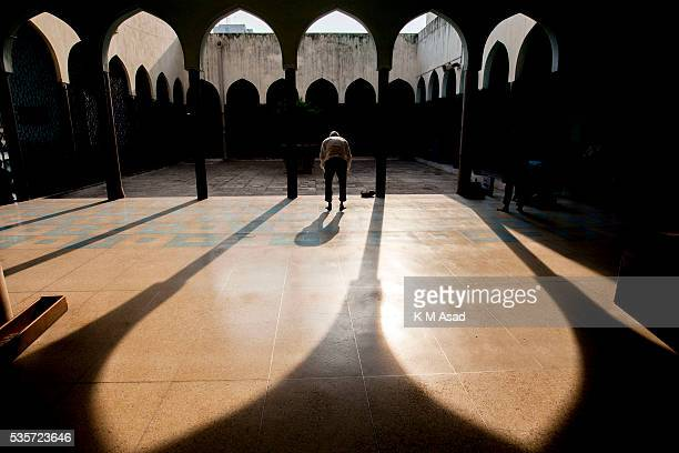 Muslim man prays during a special prayer at the National Mosque of Bangladesh to mark ShabeBarat or 'night of forgiveness' in Dhaka Bangladesh May 22...