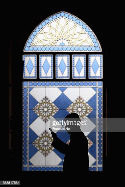 Muslim man prays during the holy month of Ramadan at Al Farooq Mosque on June 8 2016 in Dubai United Arab Emirates Muslim men and women across the...