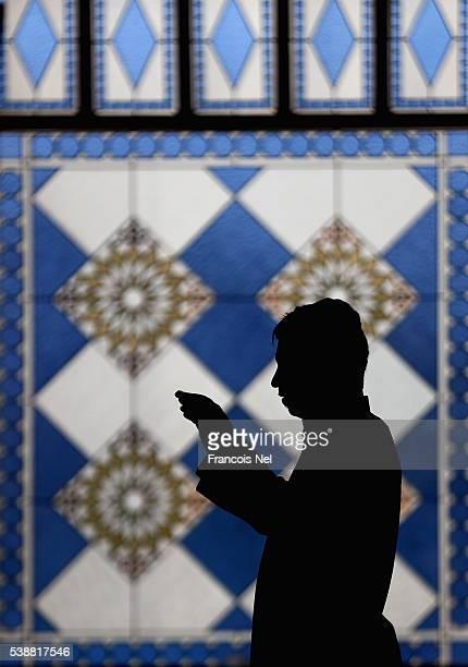 Muslim man prays during the holy month of Ramadan at Al Farooq Mosque on June 8 2016 in Dubai United Arab Emirates Muslim men and women across the...