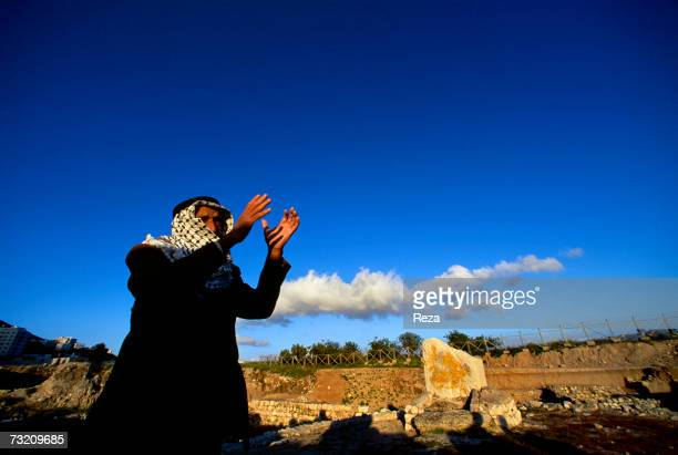 Muslim man prays in front of the assumed altar built by the prophet Abraham in the biblical city of Shechem the ruins uncovered on the eastern edge...