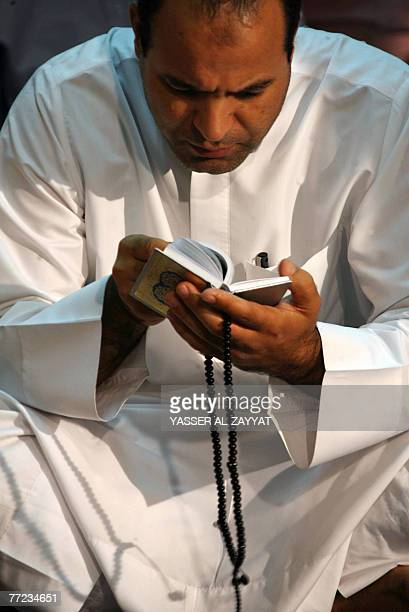 A Muslim man prays in Kuwait City's Grand Mosque just before daybreak early 09 October 2007 during Laylat alQadr which falls on the 27th day of the...