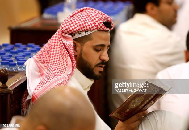 A Muslim man prays in Kuwait City's Grand Mosque just before daybreak during Laylat alQadr or Night of Destiny during the holy month of Ramadan on...