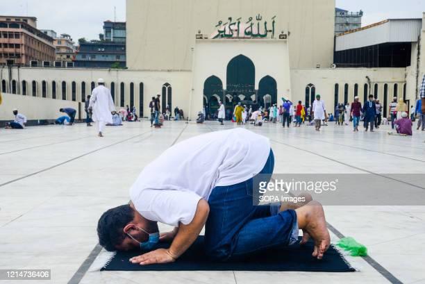 Muslim man prays on the last Friday of the Islamic holy fasting month of Ramadan at the Baitul Mokarrn National mosque amid Coronavirus crisis. The...