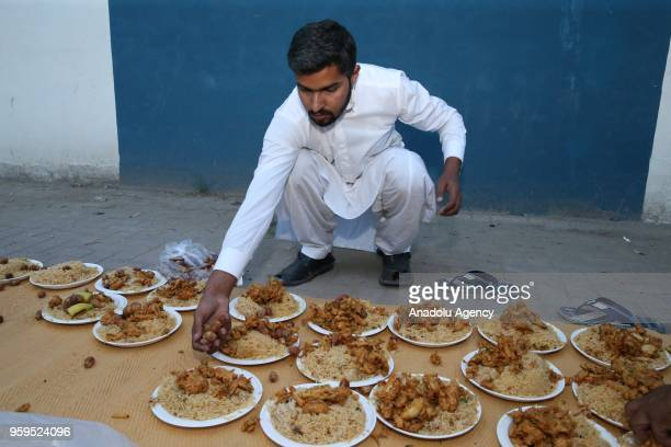 Muslim man prepares the plates for the iftar dinner on the first day of holy Islamic month of Ramadan in Islamabad Pakistan on May 17 2018...