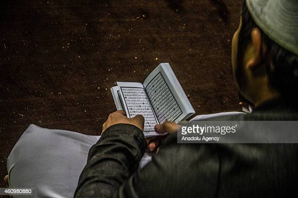 Muslim man reads Quran at AlHussein Mosque in Cairo Egypt on January 02 2015 Egypt will celebrate the Mawlid al Nabi a holy day for the birthday of...