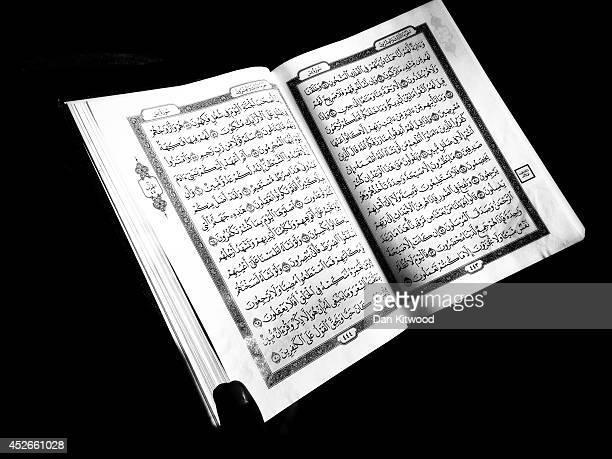 A Muslim man reads the Koran while observing a spiritual seclusion called Itikaf at the East London Mosque on July 24 2014 in London England Ramadan...