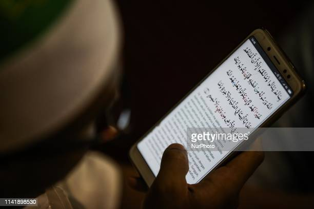 A muslim man reads the Koran with smartphone during the holy fasting month of Ramadan at the Istiqlal mosque in Jakarta Indonesia on 7 May 2019