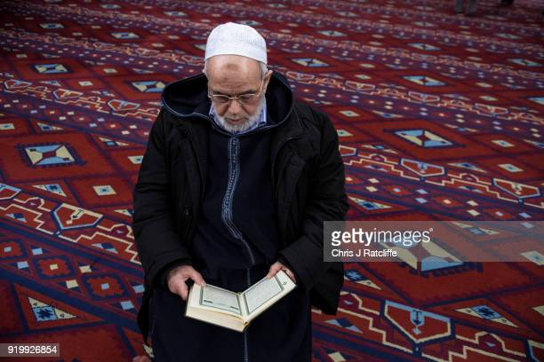 Muslim man reads the Quran in the prayer room at Al Manaar mosque on Visit My Mosque Day on February 18 2018 in London England Visit My Mosque Day is...