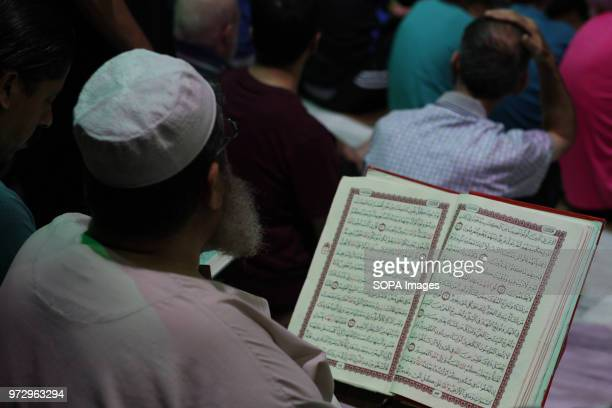 A muslim man seen reading the Quran during the night prayer Palestinian worshippers attend a night prayer during Laylat AlQadr on the 27th day of the...