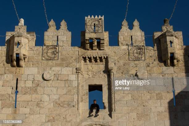 Muslim man sits on Damascus Gate in Jerusalem's old city a head of the first evening of the holy Muslim month of Ramadan on April 12, 2021 in...