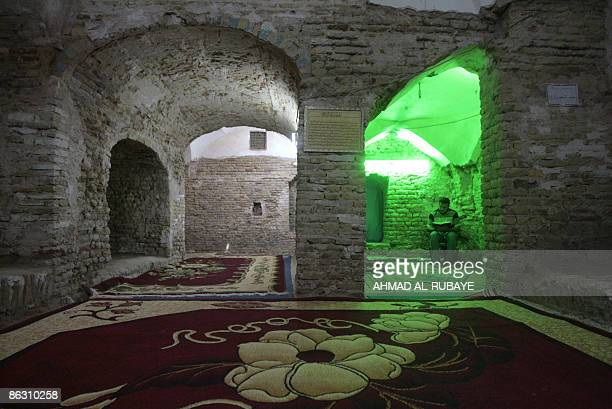 Muslim man sits praying in one of the alcoves at the shrine of the Jewish prophet Ezekiel now a mosque in the little town of Kifl south of Baghdad on...