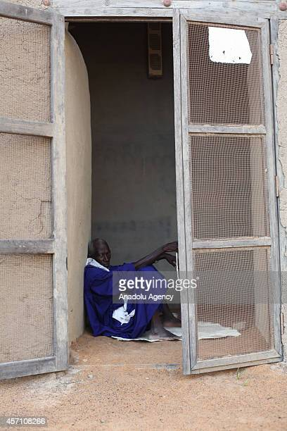 A muslim man takes a rest inside of the mud mosque in Djenne Mali on October 6 2014 The Great Mosque of Djenne is the largest mud brick building in...