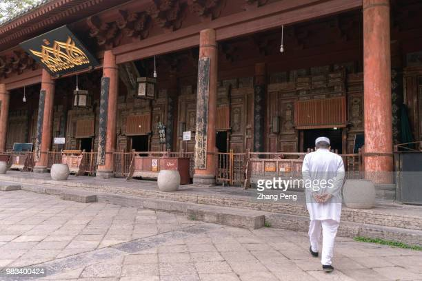 XI'AN SHAANXI PROVINCE CHINA A muslim man walks towards the main hall of Xi'an Great Mosque Xi'an Great Mosque which is a blend of traditional...