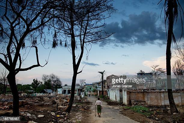 Muslim man wanders among the ruins of his home after waves of violence led against Muslims by Buddhists during the riots of March 2013 in the last...